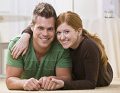 Happy Couple Lying Together On Their Apartment Floor — Stock Photo