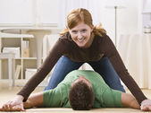 Playful Redhead Pinning Man — Stock Photo