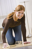 Cute Redhead Woman Cleaning Up a Spill — Stock Photo