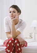 Woman on Bed Wearing Red Polka Dot Pajamas — Stock Photo