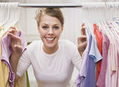 Woman looking through closet — Stock Photo