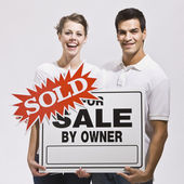 Couple with For Sale by Owner Sign — Stock Photo