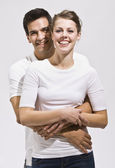 Attractive Couple Hugging and Smiling — Stock Photo