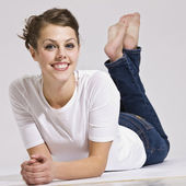 Attractive Woman Lying Down and Smiling — Stock Photo