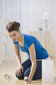 Young Woman Cleaning Water Spill — Stock Photo