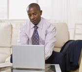 African American male with laptop — Stock Photo