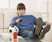 Brunette guy watching TV — Stock Photo