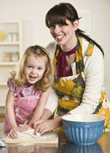 Woman and Child Kneading Dough — Stock Photo