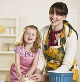 Mom and daughter making bread — Stock Photo