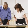 Man and Woman Working in Office — Stock Photo #18772415