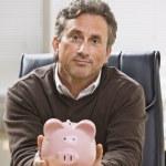 Man Holding Piggy Bank — Stock Photo #18775369