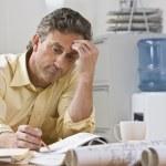 Man Working on Blueprints — Stock Photo