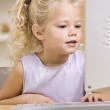 Little Girl Using Computer — Stock Photo #18778437
