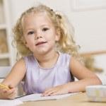 Girl Coloring in Books — Stock Photo #18778545