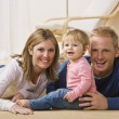 Young Family Smiling — Stock Photo
