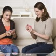 Stock Photo: Mother and Daughter Playing Cards