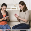 Mother and Daughter Playing Cards - Stock Photo