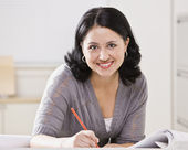 Beautiful Hispanic Woman Writing — Stock Photo