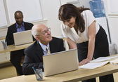Attractive woman helping older man. — Stock Photo