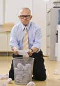 Attractive male senior searching the garbage. — Stock Photo