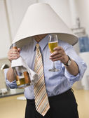 Male with Champagne Wearing a Lampshade — Stock Photo