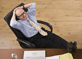 Attractive senior business man relaxing. — Stock Photo