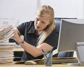 Woman Looking Through Paperwork — Stock Photo