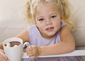 Girl Drinking Hot Chocolate out of Mug — Stock Photo