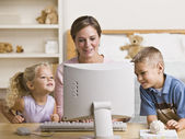 Woman and Children Playing on Computer — Stock Photo