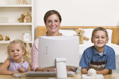 Woman and Children on Computer — Stock Photo
