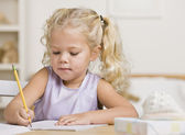 Girl Writing in a Notebook — Stock Photo