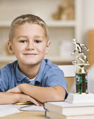 Boy Sitting in Front of Soccer Trophy — Stock Photo