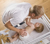Man Changing Baby — Stock Photo