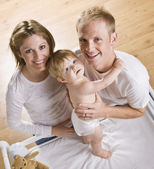 Couple with Baby on Changing Table — Stock Photo