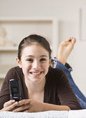 Smiling Teenager Holding Cellphone — Stock Photo