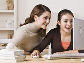 Mother on Daughter on Computer — Stock Photo