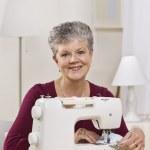 Woman on Sewing Machine — Stock Photo