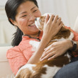 Royalty-Free Stock Photo: Woman Cuddling Dog