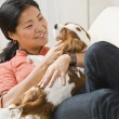 Asian woman with puppy. — Stock Photo #18781751