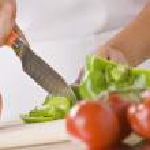 Woman Slicing Produce — Stock Photo
