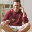 Man With Cell Phone and Salad — Stock Photo