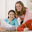 Teacher helping student in classroom - Foto Stock