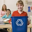 Stock Photo: Girl holding recycling bin
