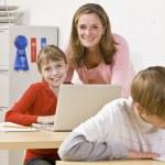 Teacher helping student — Stock Photo