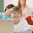Student using laptop in classroom — Stock Photo