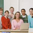Teacher posing with students — Stock Photo
