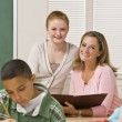Stock Photo: Teacher helping student