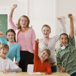 Teacher and students cheering — Stock Photo #18784593