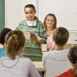 Student giving report in classroom — Stock Photo #18784729