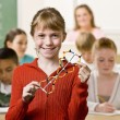 Student holding helix in classroom — Stock Photo